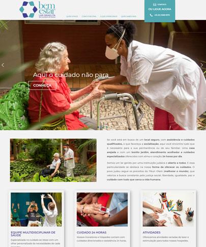 Foto da home do site Bem Estar, cfoto principal uma mulher de jaleco e mascara dando a mão para uma Sra sentada em um banco de jardim e com um andado na sua frente. Texto do Banner - Aqui o cuidado não para